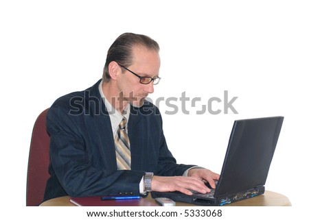 Middle aged  workaholic, businessman working on  laptop.