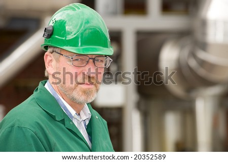 Middle ages industrial worker in front of some tubes - stock photo