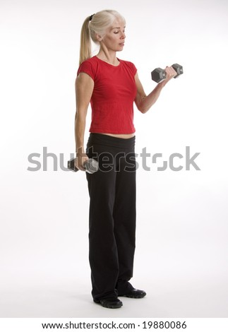 Middle-agred woman working out with weight isolated against white background - stock photo