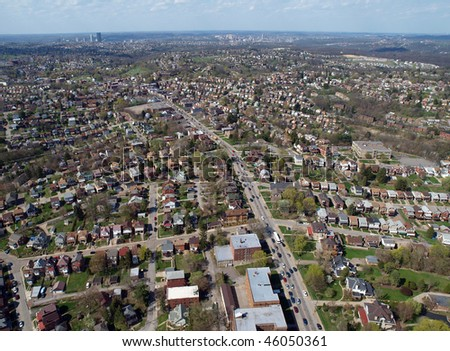Middle America aerial, high over Pittsburgh Pennsylvania neighborhoods. - stock photo