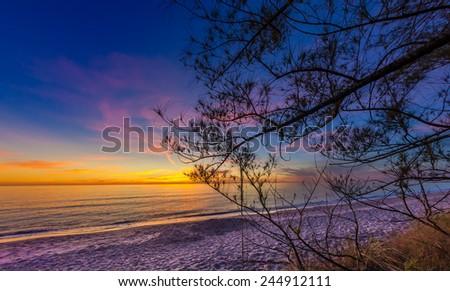 Middle beach on Manasota Key at Sunset. - stock photo