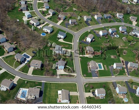Middle class homes and yards in a modern eastern US bedroom community. - stock photo