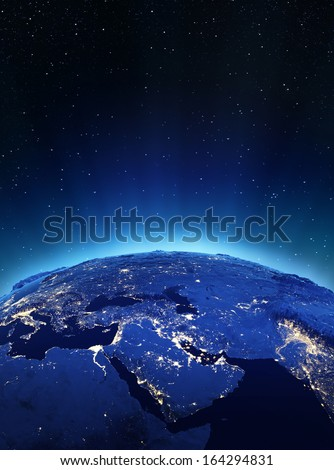 Middle East city lights. Elements of this image furnished by NASA - stock photo