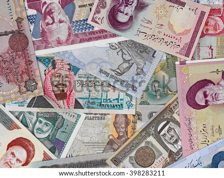 Middle east money, heap of various middle east banknotes, currency background  - stock photo