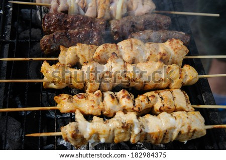 Middle East-style barbecue with kebabs and kofta - stock photo