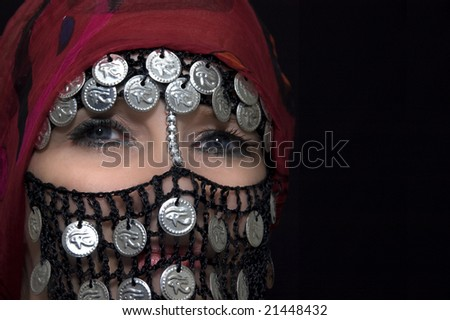 middle eastern belly dancer with traditional veil - stock photo