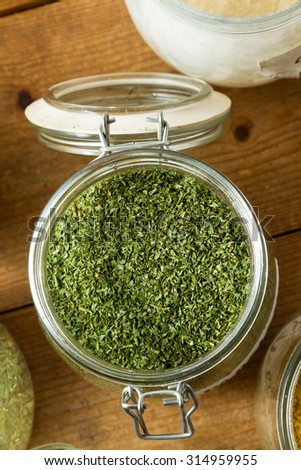 Middle Eastern cuisine: close-up on jar of dried parsley. - stock photo