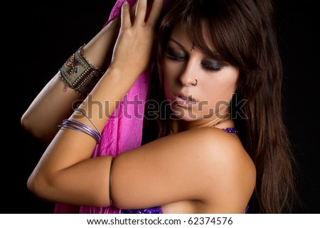 Middle eastern cultural belly dancer - stock photo