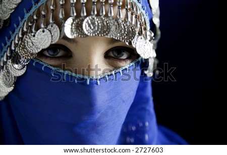 middle eastern culture: belly dancer with traditional veil - stock photo