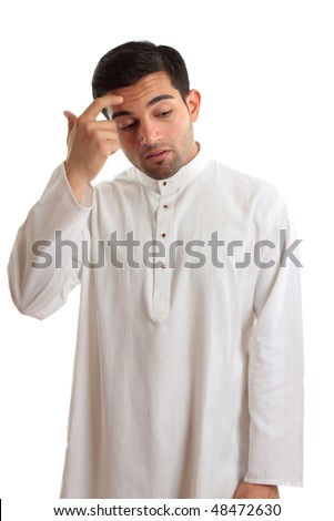 Middle eastern ethnic man wearing a robe, kurta, dishdash, thoub, etc held together with ruby inset buttons.  He is scratching forehead and pondering an issue or contemplating a decision - stock photo