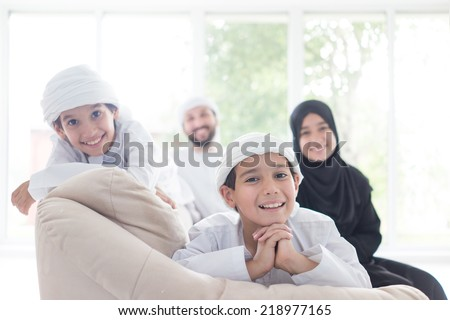 Middle eastern family at home on couch - stock photo
