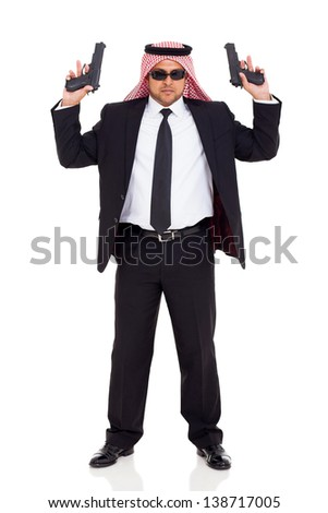 middle eastern hitman in black suit holding two handguns on white background - stock photo