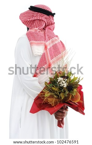 Middle eastern man hides behind a roses for his wife - stock photo