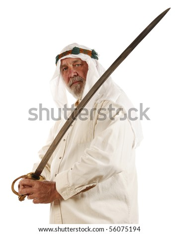 Middle Eastern man with a traditional sword weapon - stock photo