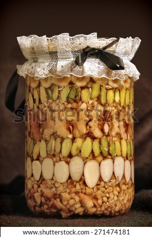 Middle Eastern treat, nuts pickled in honey - stock photo
