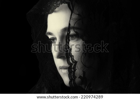 Middle Eastern woman portrait looking sad with a black hijab artistic conversion - stock photo