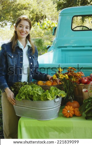 Middle Eastern women at organic farm stand - stock photo