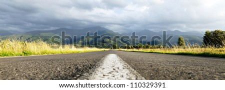 Middle of the road in the middle of nature - stock photo