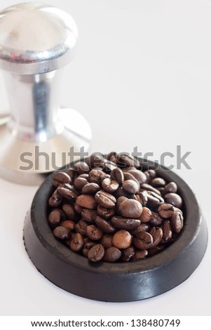 Middle roasted coffee bean in rubber saucer