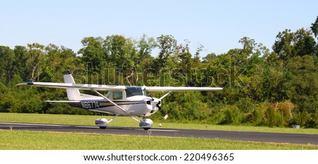 MIDDLESEX, VA - SEPTEMBER 27, 2014: A Cessna plane taxiing to The start of the Hummel field airport runway in the wings wheels and keels annual show at the Hummel airfield airstrip in Middlesex VA