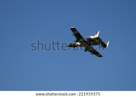 MIDDLESEX, VA - SEPTEMBER 27, 2014: A 1/4 scale USAF RC Jet flying high above Hummel field airport runway in the wings wheels and keels annual show at the Hummel airfield airstrip in Middlesex VA