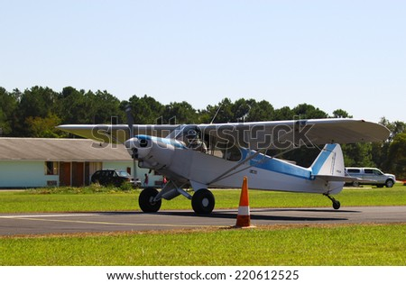 MIDDLESEX, VA - SEPTEMBER 27, 2014: A Super Cub headed down the runway for takeoff at Hummel field airport in the wings wheels and keels annual show at the Hummel airfield airstrip in Middlesex VA
