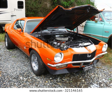 Middlesex, VIRGINIA - SEPTEMBER 26, 2015: An orange 70's Chevrolet Camaro SS at the Wings Wheels & Keels 19th annual event held each September in Middlesex VA  - stock photo
