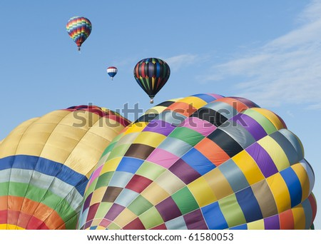 MIDLAND, MICHIGAN-SEPTEMBER 17:  Hot air balloons participate in the 20th annual Balloon Festival fly on September 17, 2010 over Midland, MI countryside. This year 65 balloons participated. - stock photo