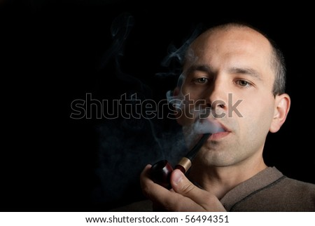midle age men smoke tobacco pipe and thinking