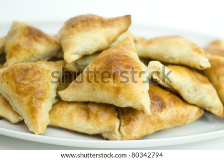 Midle Asian pies with meat, samsa on white background - stock photo