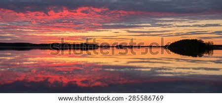 Midnight light over calm lake - stock photo