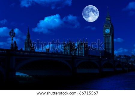 Midnight picture of the Big Ben and Westminster Bridge in London with a full moon - stock photo