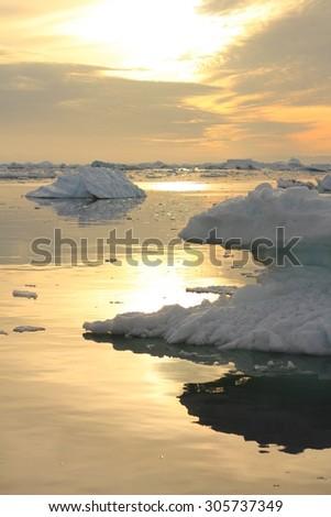 Midnight sun boat tour in Ilulissat, Greenland before 2012 melting. - stock photo