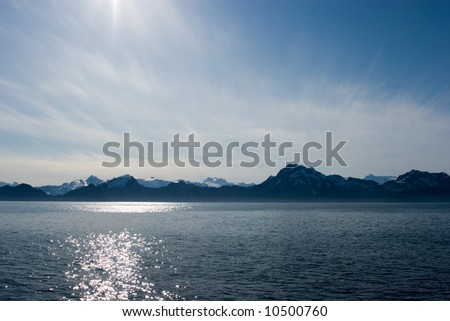 Midnight sun over the mountains in Alaska - stock photo