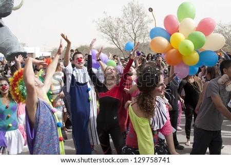 MIDRESHET BEN-GURION - FEBRUARY 22: An unidentified children walk down  the street during a procession on the feast of Purim, February 22, 2013 in Midreshet Ben-Gurion, Israel. - stock photo