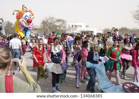 MIDRESHET BEN-GURION, ISRAEL - FEBRUARY 22: unidentified children during a procession on the feast of Purim, February 22, 2013 in Midreshet Ben-Gurion, Israel - stock photo