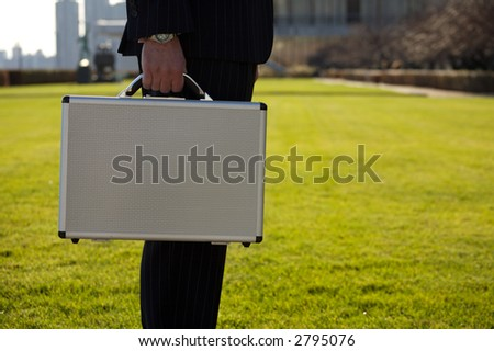 Midsection of a man with a briefcase