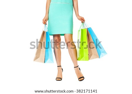 Midsection of beautiful woman with shopping bags isolated on white background. Shopping concept.