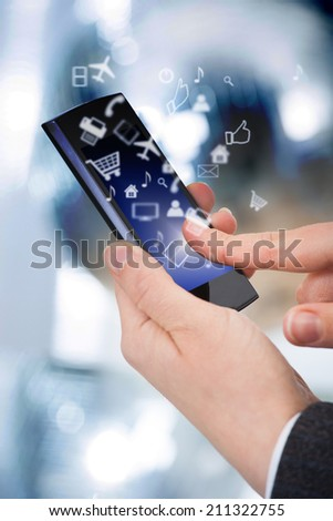 Midsection of businessman using smart phone with various icons - stock photo
