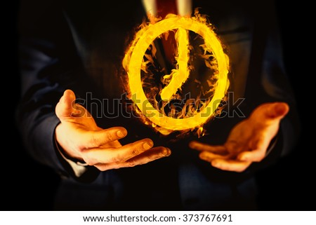Midsection of businessman with arms out against black - stock photo