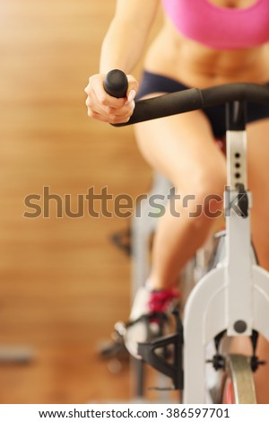 Midsection of sporty group of women on spinning class - stock photo