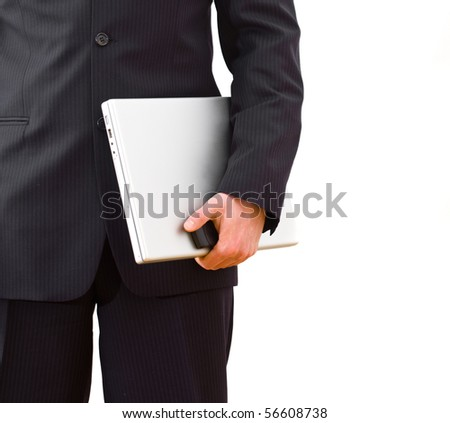 Midsection of welldressed businessman holding laptop computer and mobile phone. Isolated on white background.