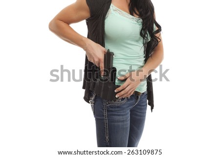 Midsection of woman drawing handgun from holster - stock photo