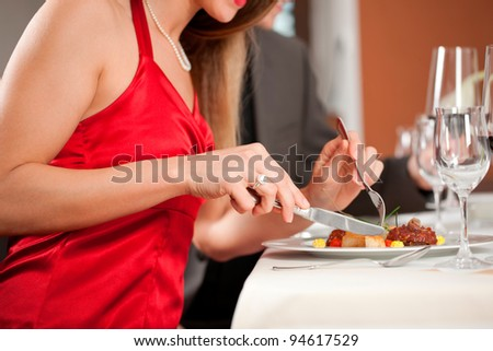 Midsection of woman having dinner with her boyfriend at hotel - stock photo