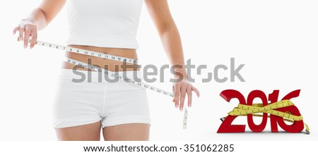 Midsection of woman measuring waist against white background with vignette - stock photo