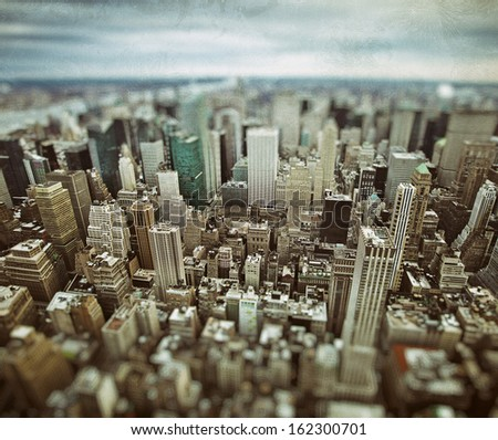 Midtown and lower Manhattan in New York City with grunge vintage overlay effect - stock photo