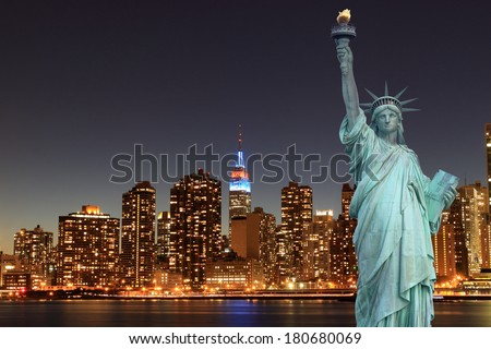Midtown Manhattan Skyline and The Statue of Liberty at Night, New York City  - stock photo