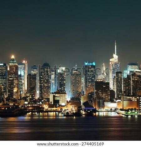 Midtown Manhattan skyline at dusk panorama over Hudson River - stock photo