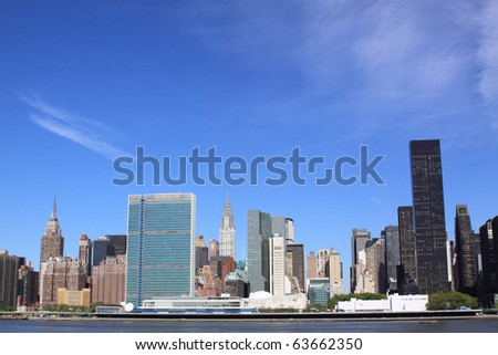 Midtown Manhattan skyline on a Clear Blue day, New York City - stock photo