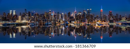 Midtown Manhattan skyline reflected in Hudson River at dusk - stock photo